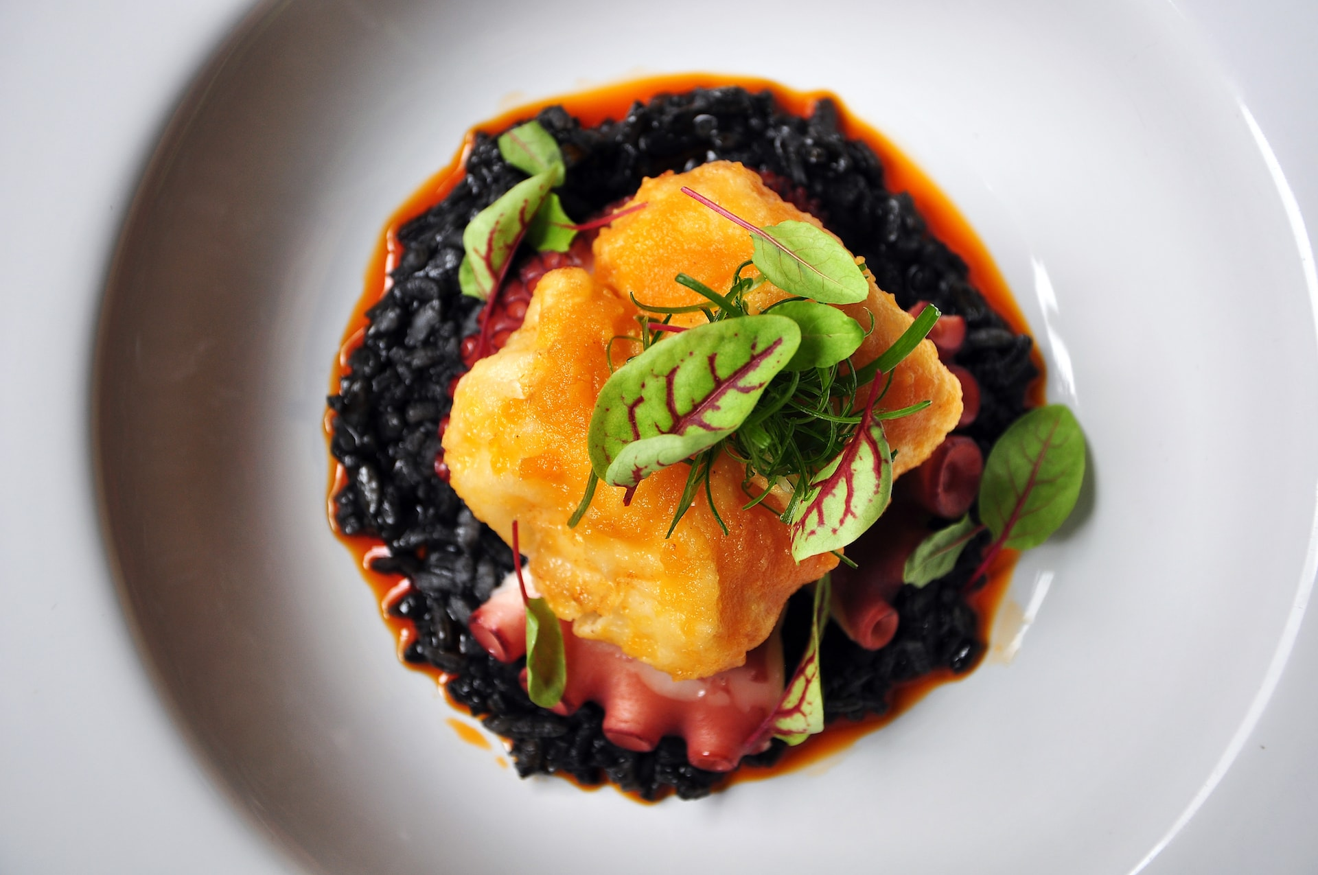 Signature-Salted-Egg-Yolk-Grouper-with-Torched-Octopus-Squid-Ink-Risotto-2-min Indigo at The Blue Mansion