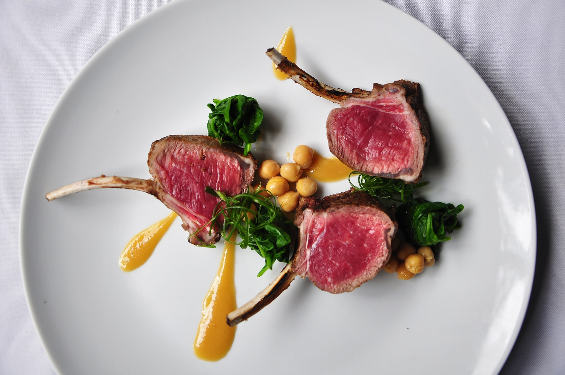 Grilled-Rack-of-Lamb-with-Spinach-Chickpeas-Garlic-Miso-min Indigo at The Blue Mansion